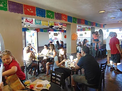 people sitting at tables in a Mexican restaurant