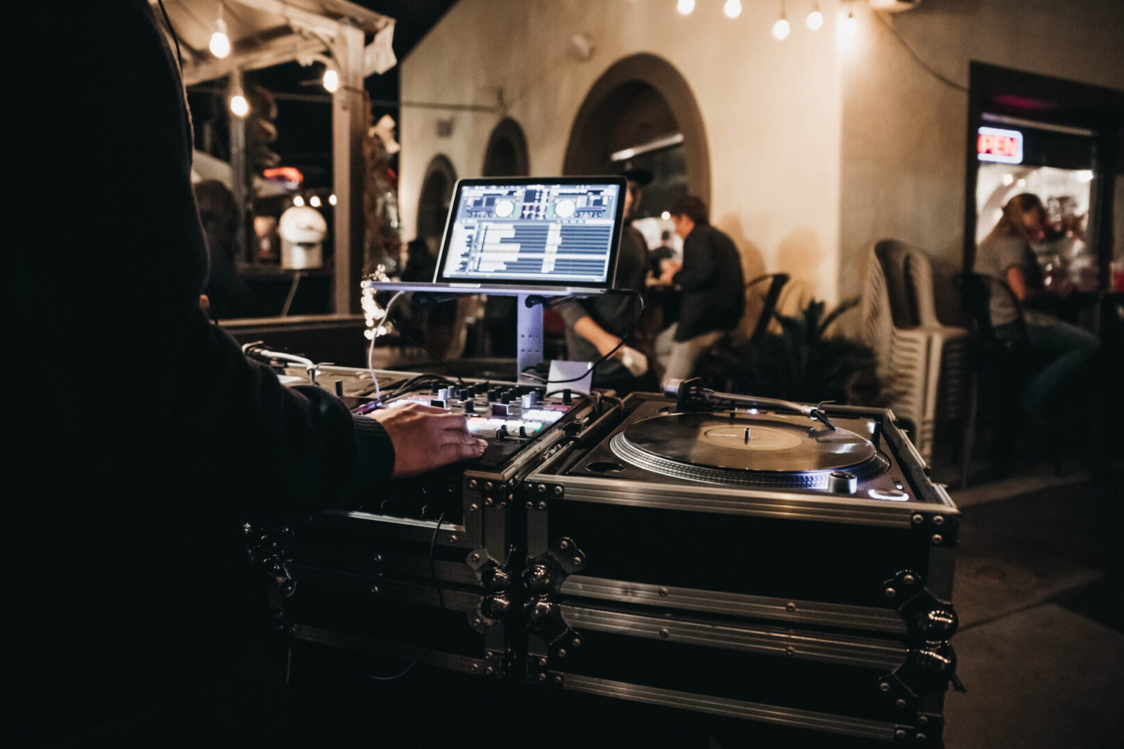 dj playing music in his booth